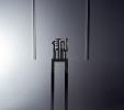 Omaggio a G. Morandi (1994)   Installazione   Acciaio inossidabile lucidato e cornice in gesso   cm 162x33x12